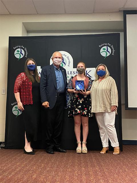 Pictured from left: Morgan Thompson, MSW, CEO of Prevention Links; Senator Raymond J. Lesniak; Lisa Kline and Pamela Capaci, CEO of HOPE Sheds Light.